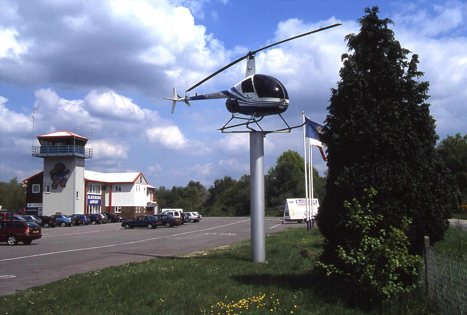 A Robinson R-22 on a pole in 2004